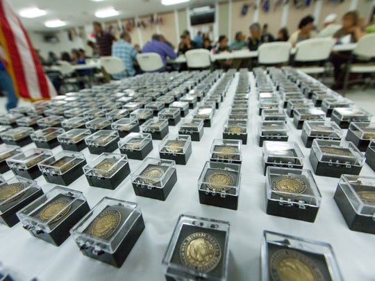 Hundreds of Vietnam veteran lapel pins are displayed on Tuesday, March 29, 2016, at the American Legion Post 10 during a 50th anniversary commemoration of the war at Las Cruces Vet Center.
