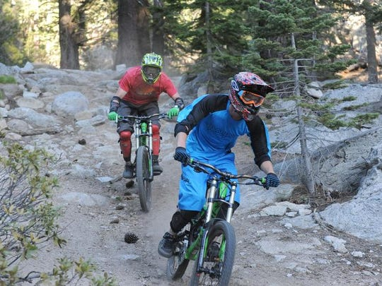 Ben Paula, in blue, and Cam Rose enjoy an after-work ride down the Tyroliam Trail in Incline Village near Diamond Peak Ski Resort. Mountain biking and hiking improvements are planned for Diamond Peak.