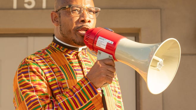The Rev. Ron Rawls led scores of protesters in a march from the St. Augustine Police Department on Monday, June 1, 2020 to protest the death of George Floyd at the hands of officers from the Minneapolis Police Department.