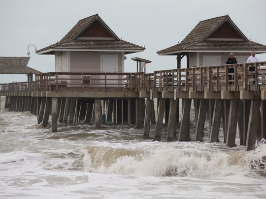 Steady winds and high waves forced city officials to close the Naples Pier for safety reasons Monday, Jan. 23, 2017.