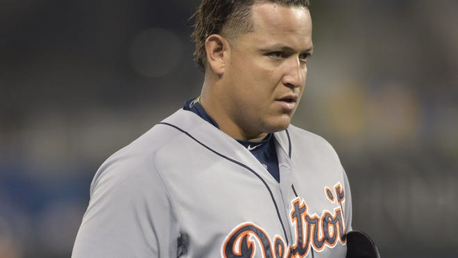 Tigers first baseman Miguel Cabrera walks to the dugout after being ejected in the fourth inning  of the Tigers' 12-1 loss to the Royals Wednesday in Kansas City, Mo.