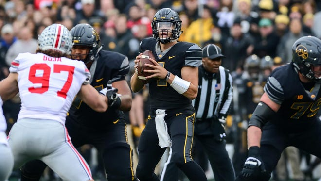 Iowa Hawkeyes quarterback Nathan Stanley (4) looks to throw a pass during the first quarter against the Ohio State Buckeyes at Kinnick Stadium.
