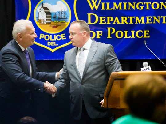 Wilmington mayor Mike Purzycki shakes hands with new police chief Robert J. Tracy during a press conference to introduce the chief at the Chase Center on the Riverfront in Wilmington on Wednesday afternoon.