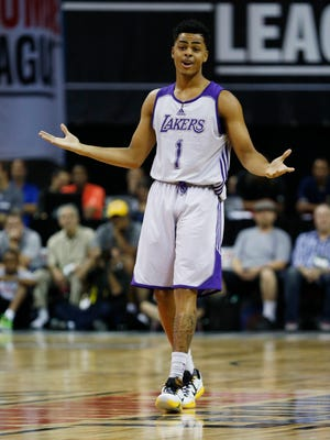 Los Angeles Lakers' D'Angelo Russell reacts after scoring against the Minnesota Timberwolves during the first half of their NBA summer league basketball game Friday, July 10, 2015, in Las Vegas. (AP Photo/John Locher)