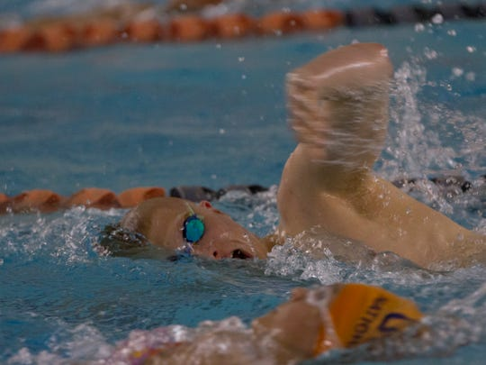 Robert Griswold, a senior at Freehold Township H.S., a world class disabled swimmer, practices with his club teammates at the Ocean County YMCA. Peter Ackerman/Staff Photographer