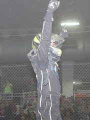 Alex Bright salutes the crowd after winning a race at the Chili Bowl event Tuesday.