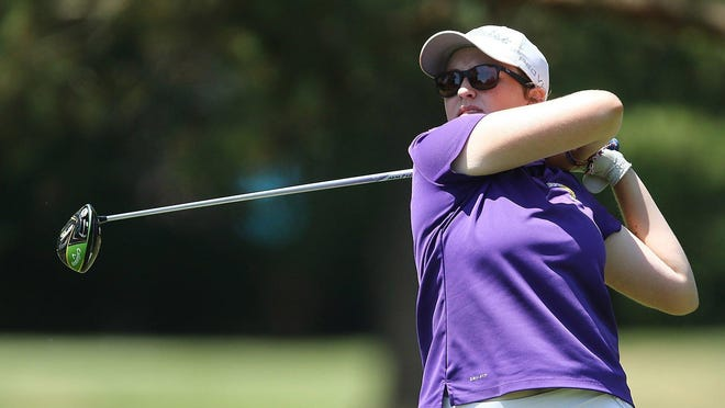 Avery Wright watches her drive on hole 17 during the First Tee tournament at Tannenhauf Golf Club on Monday.