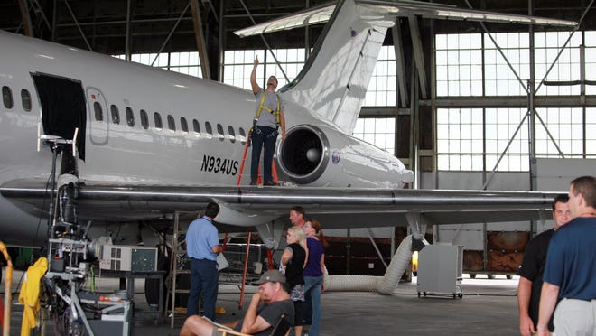 A film crew works at Willow Run Airport in 2011.