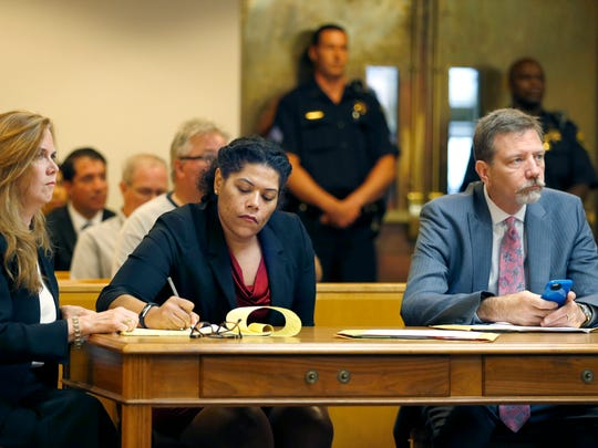 Judge Leticia Astacio during her court appearance with attorneys Bridget Field and Mark Young.