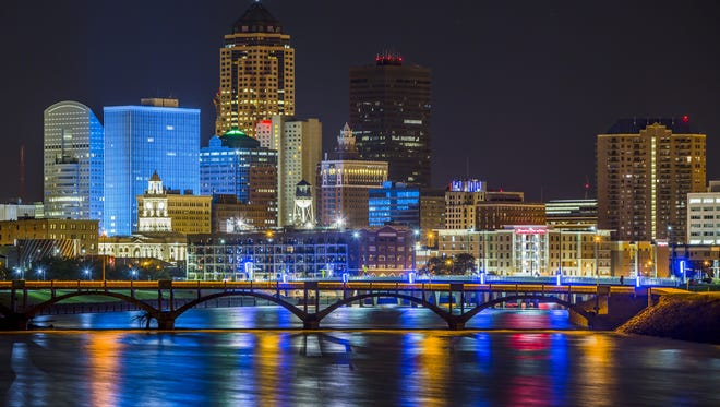The Des Moines skyline shines over the confluence of the Des Moines and Raccoon rivers on Aug. 25, 2015.