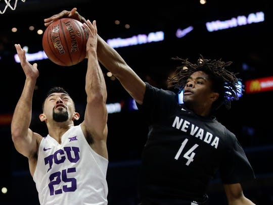 Lindsey Drew, right, said Tuesday that he would return to Nevada for his senior season.