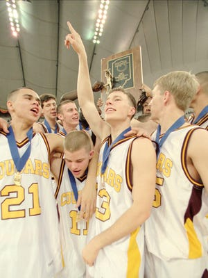 Bloomington North players celebrate winning the 1997 IHSAA boys basketball state title.