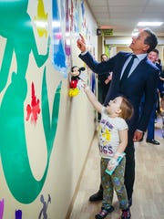 Robert A. Iger, Chairman and Chief Executive Officer of The Walt Disney Company is given a tour by patient Reagan Chodakowski Wednesday, April 11, 2018, during an unveiling of original artwork recently installed in the Variety Pediatric Emergency Department at Blank Children's Hospital, designed by Walt Disney artists.