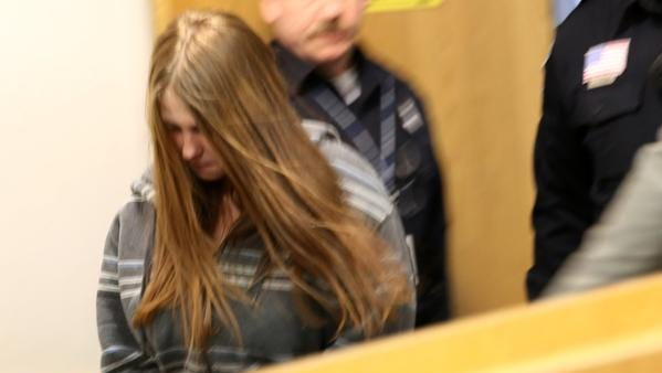 Angela Alexie 24, of Eastpointe, Mich., enters the courtroom for her arraignment on Wednesday, Jan. 28, 2015.