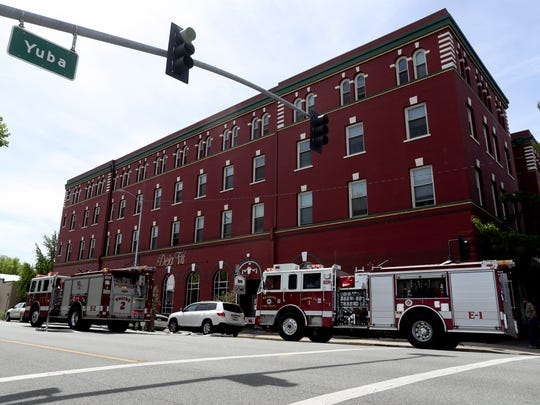 Lorenz Hotel residents in downtown Redding evacuate Tuesday after smoke was seen coming from the building's basement. A breaker panel failed and caused a power outage, leading to an overnight evacuation of residents.