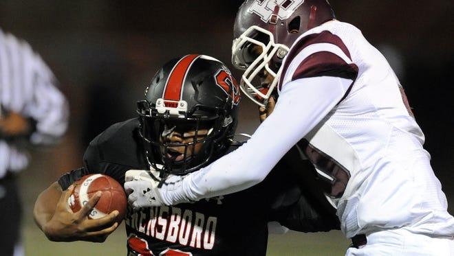 Henderson County's Dajuan Simpson chases down Owensboro's Landon Board during last season's game at Rash Stadium. Simpson will play tailback and safety this season.