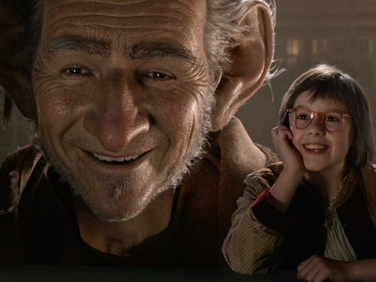 "This image released by Disney shows Ruby Barnhill, right, and the Big Friendly Giant from Giant Country, voiced by Mark Rylance, in a scene from""The BFG."" (Disney via AP)"