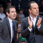 Notre Dame assistant coach Martin Ingelsby (left) speaks to head coach Mike Brey during a game.