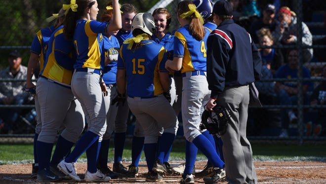 The Panthers engulf Rylei Miller after her home run against visiting John Glenn on Wednesday.