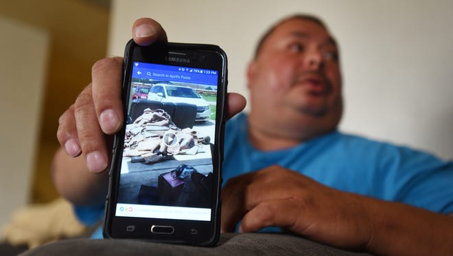 Mike Johnson shows videos of the damage done to his daughter's home in Dickinson, Texas after Hurricane Harvey dumped more than 50 inches of rain on the area.