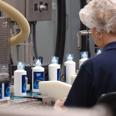 A Bausch + Lomb  employee works to produce eye care products at the company's Greenville plant in this 2008 photo.