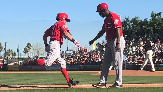 Reds CF T.J. Friedl is congratulated by third base coach Delino DeShields as he rounds the bases following his ninth-inning home run on Saturday, March 11, 2017.