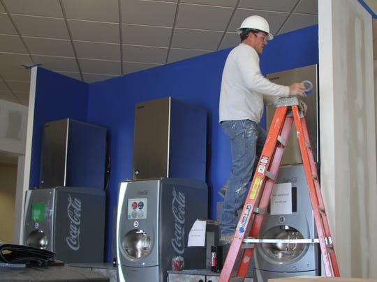 Construction crews are still busy at work at the Cavern 6 Theater at the Carlsbad Mall. Despite construction, the theater is open and operating with three screens.