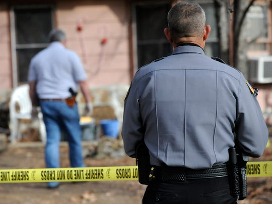 Baxter County Sheriff's Office investigators work the scene of a murder in 2012. According to data from the National Incident Based Reporting System, crime in the county was slightly down in 2014 compared to 2013. No murders were reported in 2014 and only one in 2013.
