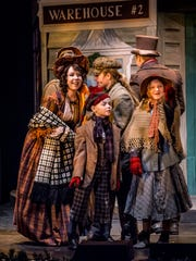 "From left, Emily Smallwood, Elliott Wakefield, Jasper Bailey Wakefield and Jocelyn Merriman perform in the Totem Pole Playhouse production of ""A Christmas Carol."""