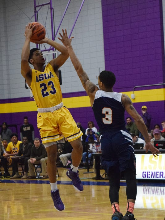 LSU at Alexandria's Jordin Williams (23, left) shoots over Langston University defender Friday.