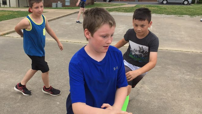 Bryan Hoskins (left), Wesley Perkey (middle) and Noah Ferguson (right), all third-graders at Amanda Gist Elementary School, play basketball Thursday. The school is offering a 16-day summer camp to first- through - fifth-grade, which will focus on science, technology, engineering and math (STEM).