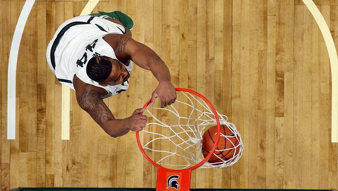 Michigan State forward Nick Ward dunks in the first half of the Spartans' 77-66 win over the Iowa Hawkeyes on Feb. 11, 2017 at the Breslin Center in East Lansing.