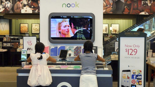 Customers look at models of the Nook at a Barnes and Noble store in Pineville, N.C.