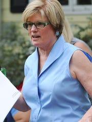 Attorney Linda Pence represents Greg Collett.