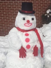 """Because sometimes it makes your heart feel good to act like a kid,"" wrote Margaret Thomas, who made this snowman in Swannanoa."