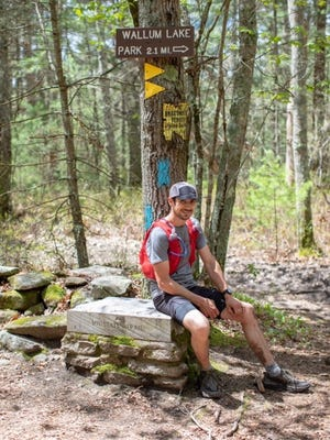 Cody Cutler is all smiles after completing his Midstate Trail run in less than 24 hours.
