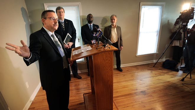 Ralph Perrey (left) with the Tennessee Housing Development Agency talks to the press in Memphis about a program which will provide $15,000 to help pay down payment and closing costs on rehabilitated properties in certain zip codes.