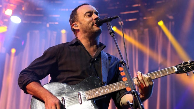 In this June 28, 2013, file photo, Dave Matthews of The Dave Matthews Band performs onstage at the Susquehanna Bank Center in Camden, N.J. The Dave Matthews Band, Justin Timberlake, Pharrell Williams and Ariana Grande will be among the performers at a free unity concert in Charlottesville on Sept. 24, 2017.