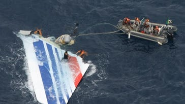 In this June 8, 2009, photo, Brazil's Navy sailors recover debris from the missing Air France Flight 447 in the Atlantic Ocean. French investigators are releasing much-awaited details July 29, 2011, about what happened in the final minutes before an Air France jet crashed in the Atlantic Ocean in 2009. The French air accident investigation agency BEA is issuing a report Friday into the crash based on readings from the so-called black box flight recorders.