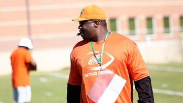Coach Earl Holmes