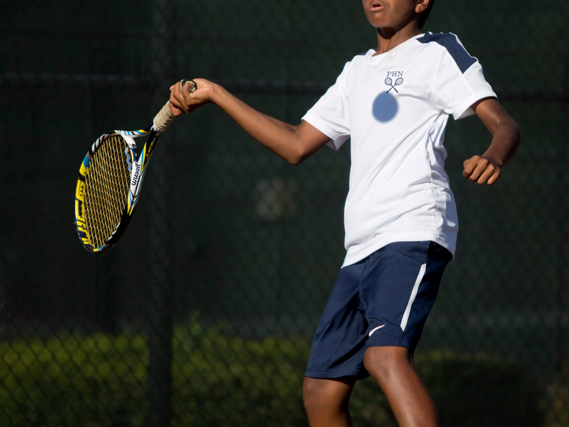 Port Huron Northern freshman Neehal Tumma returns the ball during a doubles tennis match Wednesday, September 23, 2015 at Port Huron Northern High School.