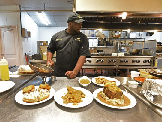 Crescent City Bistro owner Chef Darrell Johnson puts