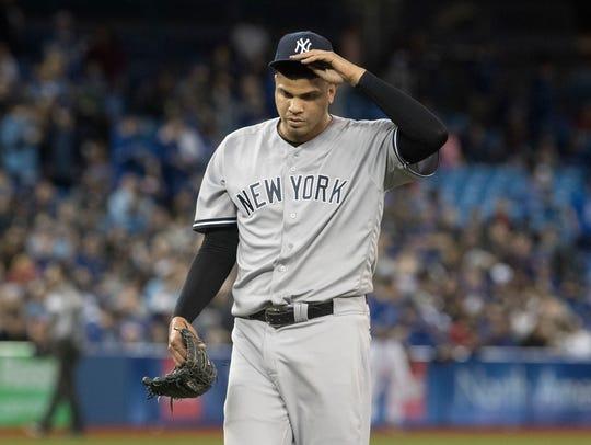 New York Yankees pitcher Dellin Betances walks off
