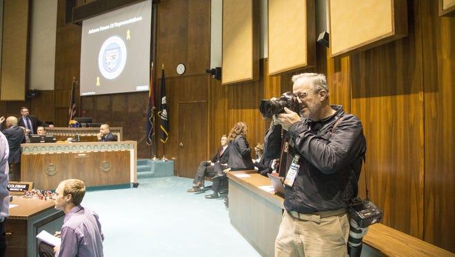 AP Photographer Ross Franklin takes photos on the House floor.