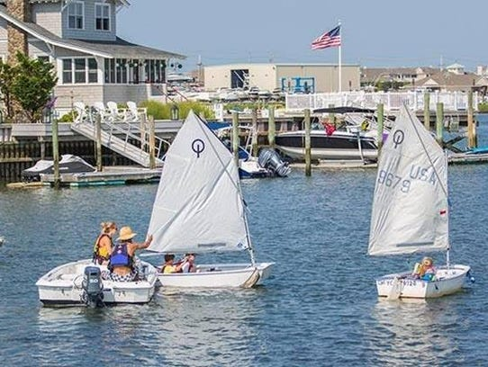 Young sailors take to the water on the back bay of