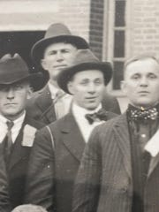 George Erlandson's father, Claus, wore a hat and bow tie in this photo of the second group of World War I draftees from Cascade County.