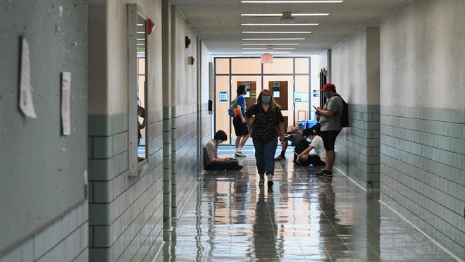 Students wait for classes to begin in the Arts and Science building on the University of Missouri campus on Aug. 24.