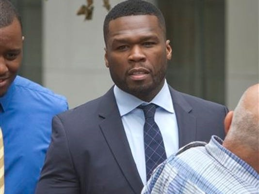 FILE - In this July 21, 2015 file photo, rapper Curtis Jackson, also known as 50 Cent, leaves court after testifying in front of the jury about his finances, his business deals and the media attention surrounding his recent bankruptcy filing, in New York.