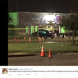 Fort Worth Police Department investigate the shooting at Studio 74 dance hall. Two people were killed and several others injured, police said Saturday.