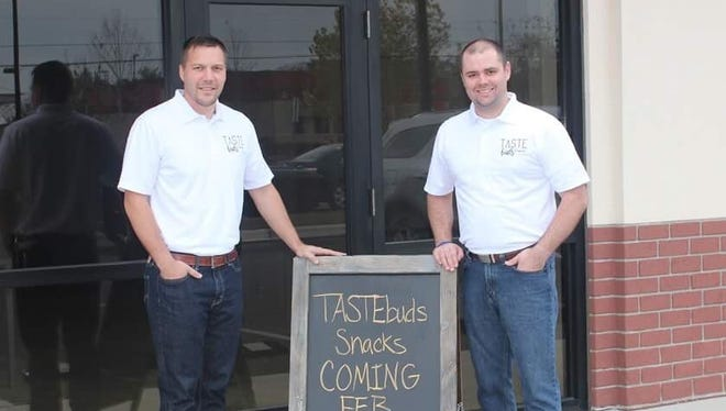 Mark Michel, left, and Michael Hobbs have opened TASTEBuds Sweet Treats and Trail Mix Bar in Pace.